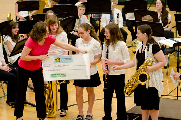 Girls Present Check to Cary Band Association